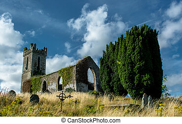 Old Church and Graveyard in Ireland - Old Church Ruin with...