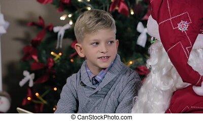 Boy Sits in Santa's Lap, Communicate.