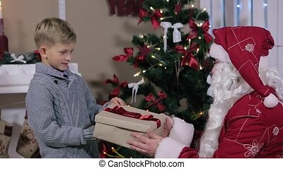 Little Boy is a Gift with Santa and Looks in a Box