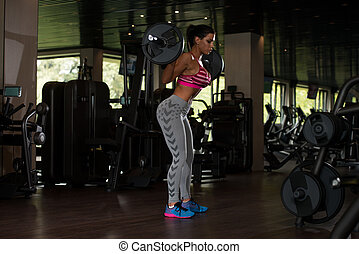 Mexican Woman Doing Exercise Barbell Squat - Sexy Latino...