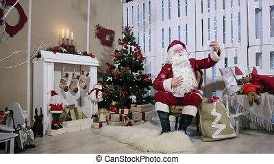 Santa Make Selfi His Smartphone, Room with Fireplace and Christmas Tree, Gifts.
