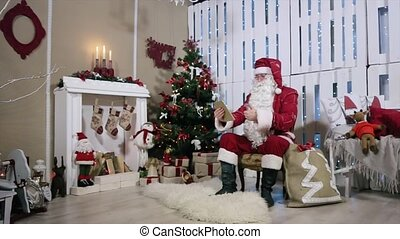 Santa Talking His Digital Tablet Room with Fireplace and Christmas Tree Gifts.