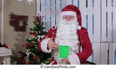 Santa Stroke Tablet with Green Screen Holding Vertical Mode....