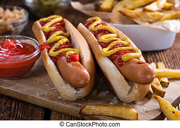 Homemade Hot Dog with ketchup and mustard on rustic wooden...