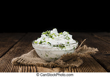 Bowl with Herb Curd (detailed close-up shot) on wooden...
