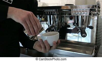 Barista makes two coffees in coffee bar HD