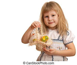 Pretty little girl holding Easter basket