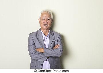 asian senior male in tablet
