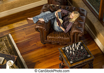 College Student Studying - A blonde female model reading a...