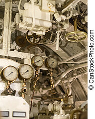 Detailed view of many manometers inside of submarine