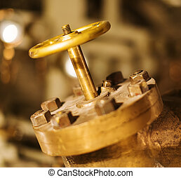 Close-up view of old gold valve.