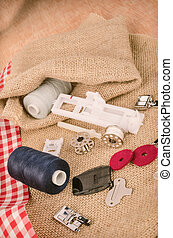 Sewing machine parts in a still life with yarn spools