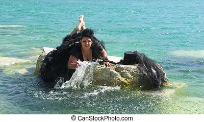 Woman In Black Splashing Lake Water