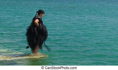 Woman In Black Having Fun in Lake