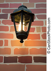 The lamp with brick pattern in background
