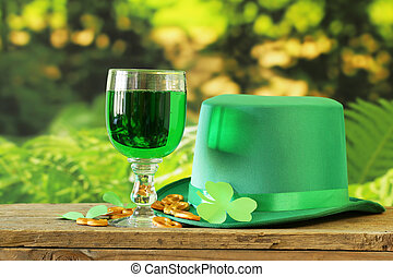 traditional symbols for Patrick's Day - green beer,...