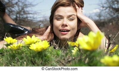 Sexy Woman Lying On The Grass At Meadow
