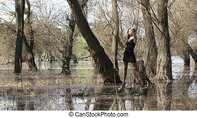 Female Model Posing At Flooded Forest - Young female model...