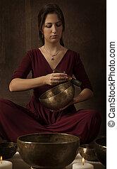 Wonderful sound of Tibetan singing bowl - Woman playing a...