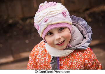 Happy child in warm clothes.