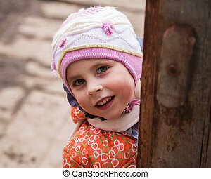 Happy child in warm clothes .