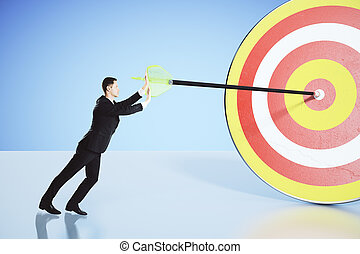 Move towards your goal concept with businessman pushing an...