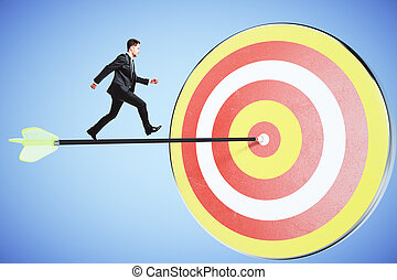 Move towards your goal concept with businessman running on...