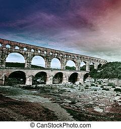 Aqueduct - Ancient Roman Aqueduct Pont du Gard at Sunset,...
