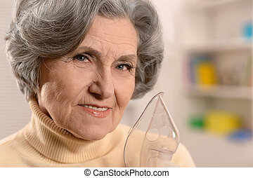 Portrait of a senior woman with inhaler