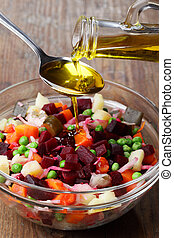 Russian beetroot salad with pouring olive oil
