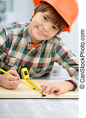 Positive boy holding tape measure - Like what you do...