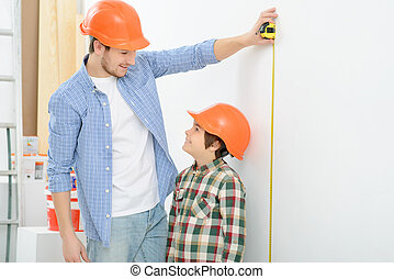 Happy father and son doing renovation - You are so big...