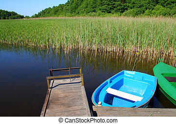 Scene at the lake - Two boats floating on the lake near the...