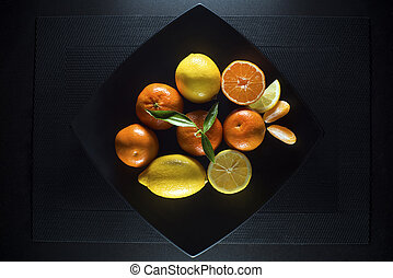 Citrus fruits - Ripe juicy tangerine, orange mandarin and...
