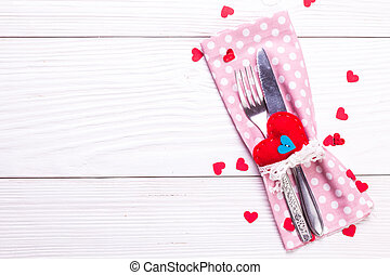 Festive table setting for Valentines Day on light wooden background