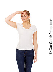 Young woman looking into the distance - Young woman looking...