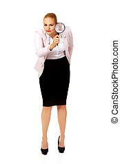 Young business woman using a magnifying glass