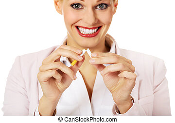 Smile business woman breaking a cigarette