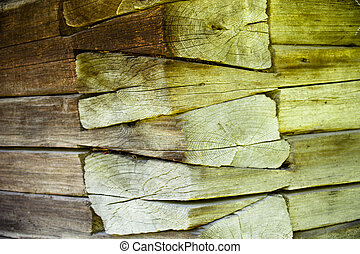 The corner of the old log house Close up Wooden texture
