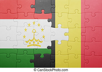 puzzle with the national flag of tajikistan and belgium ....