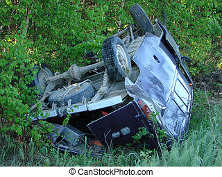 The car which moved down in a ditch as a result of accident...