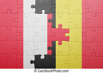 puzzle with the national flag of peru and belgium . concept