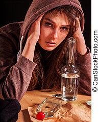 Drunk girl holding bottle of vodka. - Drunk girl holding...