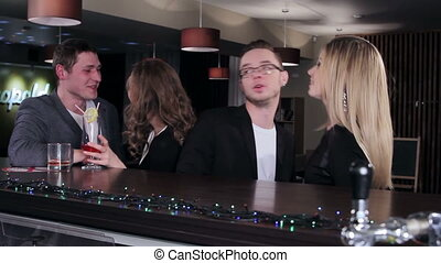 Friends at the bar - The guy orders two bottles of beer
