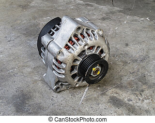 Car alternator - Old alternator for the car on concrete...