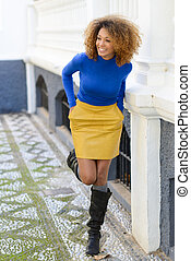 Young girl with afro hairstyle in urban background - Funny...