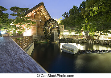 It is a waterwheel and a japan style house