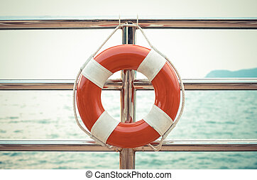 Vintage style photo of life preserver attached to the cruise...