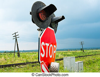 Traffic lights and signs at the railroad crossing - Traffic...