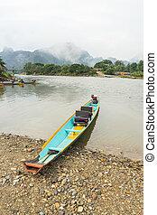 Traditional boat in Nam Song river at Vang Vieng, Laos
